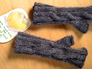 Hand knit mitts made from Coco the goat
